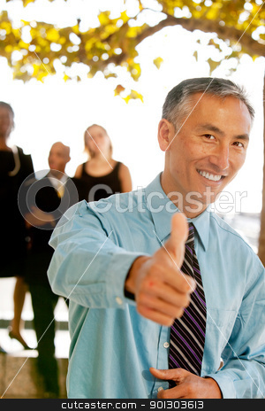Thumbs Up Business Man stock photo, A casual business man with thumbs up by Tyler Olson