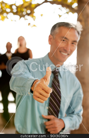 Thumbs Up stock photo, A casual business man with thumbs up by Tyler Olson