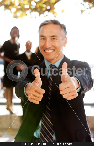 Two Thumbs Up stock photo, A business man with thumbs up - critical focus on the thumbs by Tyler Olson