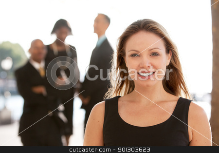 Happy Business Woman stock photo, An attractive caucasian business woman by Tyler Olson