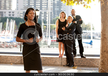 Business Team stock photo, An African American woman in front of a business team by Tyler Olson