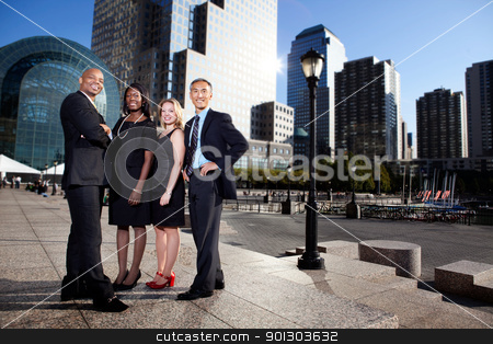 Business Team stock photo, A successful business team in an outdoor setting against a city background by Tyler Olson