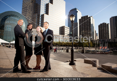 Business Success stock photo, A successful business team in an outdoor setting against a city background by Tyler Olson