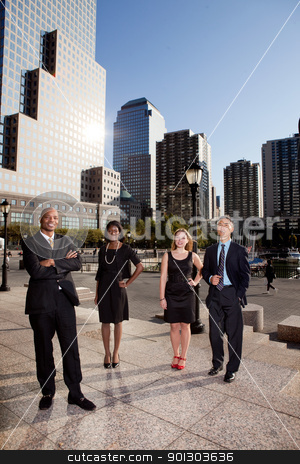 Big City Business Team stock photo, A business team portrait with large buildings in the background by Tyler Olson