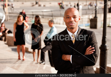 Content Business Man stock photo, A portrait of a content African American Business Man by Tyler Olson
