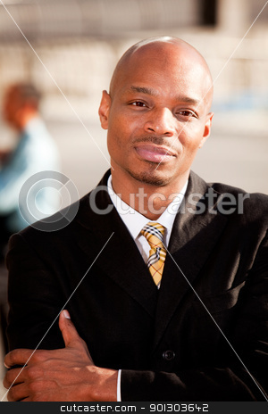 Serious Business Man stock photo, A portrait of a serious African American Business Man by Tyler Olson