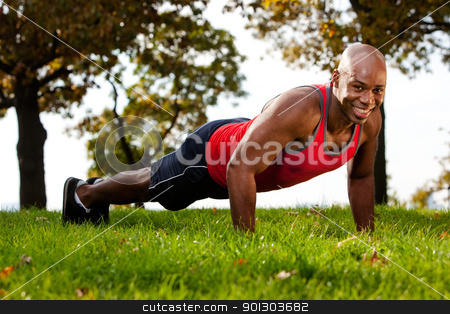 Push Up stock photo, A man doing a push up in a park by Tyler Olson