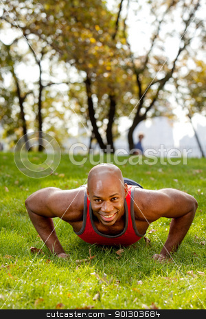 Fitness stock photo, An african american doing push ups in the park by Tyler Olson