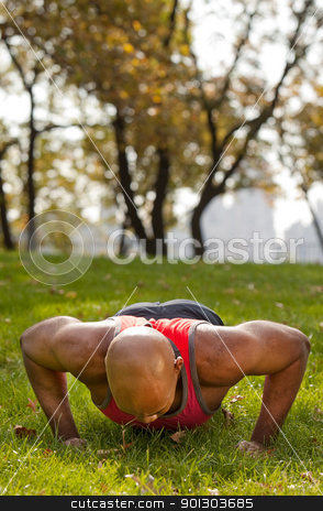 Exercise stock photo, An african american male doing push ups in a park by Tyler Olson