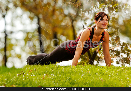 Fitness stock photo, A caucasian female doing push ups in the park by Tyler Olson