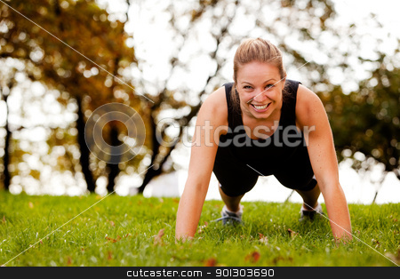 Push-Ups Exercise stock photo, A woman doing push-ups in the park by Tyler Olson