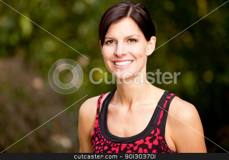 Fitness Woman stock photo, A happy fitness woman in the park - lifestyle portrait by Tyler Olson