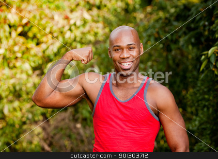 Bicep Muscle stock photo, An African American man flexing his Bicep by Tyler Olson