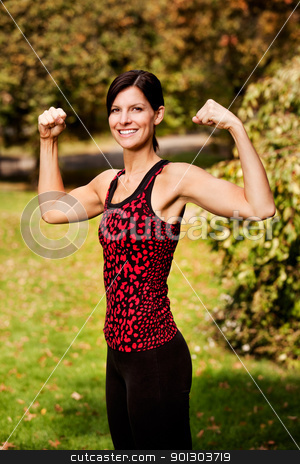 Arm Flex Fitness stock photo, A portrait of a woman flexing her bicep muscles by Tyler Olson