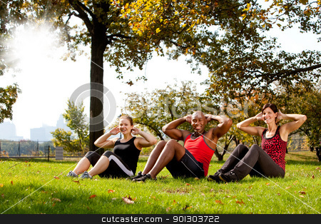Park Exercise stock photo, A group of people doing exercises in the park by Tyler Olson