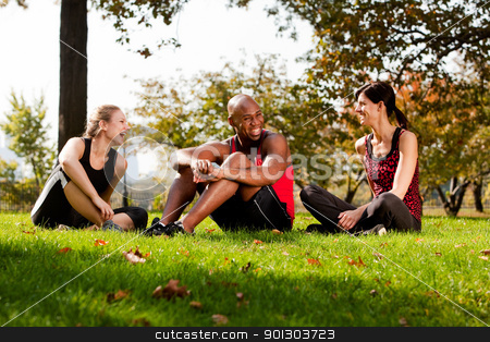 Park Friends stock photo, A group of people relaxing in the park after exercise by Tyler Olson