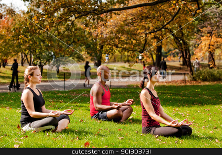 Relax City stock photo, A group of people relaxing with meditation in a city park by Tyler Olson