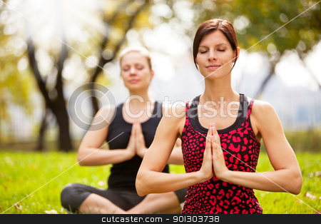 Meditate stock photo, Meditation in the a park on a warm summer day by Tyler Olson