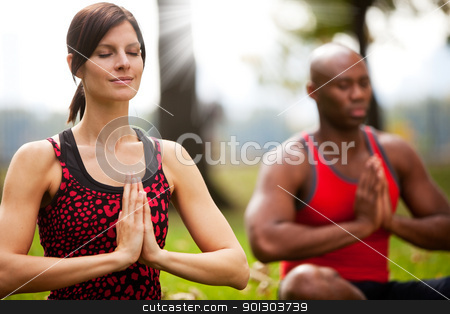 Peace Meditate stock photo, A group of people peacefully meditating in a park by Tyler Olson
