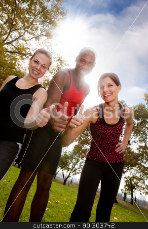 Fitness Thumb Up stock photo, A happy group of people in the park exercising by Tyler Olson