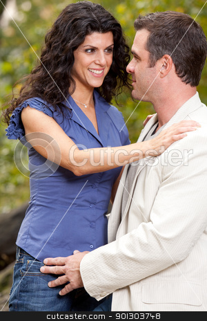 Happy Couple stock photo, A woman looking happy at her husband / boyfriend - Shallow depth of field, focus on man by Tyler Olson