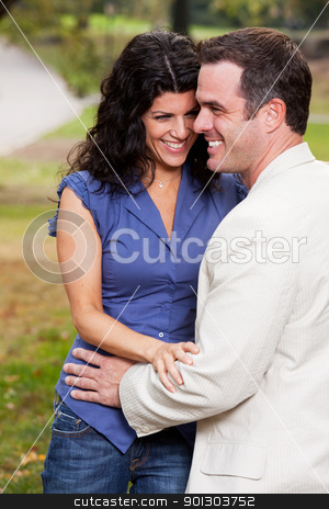 Couple Laugh stock photo, A couple having fun and laughing in the park by Tyler Olson
