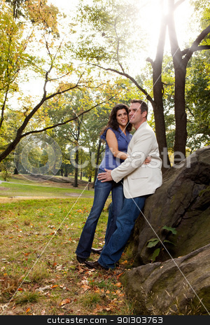 Happy Park Couple stock photo, A happy couple relaxing in the park by Tyler Olson