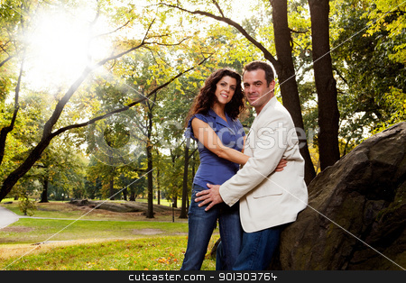 Park Portrait Engagement stock photo, A portrait of a happy couple in the park by Tyler Olson