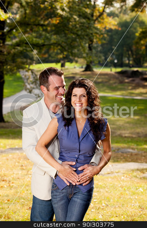 Couple Hug  stock photo, A happy couple in the park hugging by Tyler Olson
