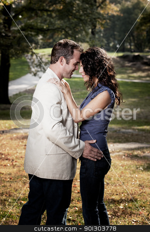 Close Couple Portrait stock photo, A happy couple looking at eachother in a park by Tyler Olson