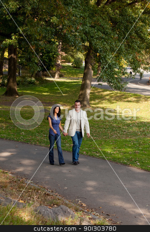 Happy Walk People stock photo, A happy couple walking in the park by Tyler Olson