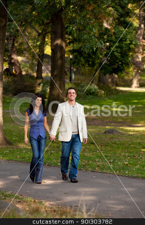 Walk Park stock photo, A happy couple walking in the park  by Tyler Olson