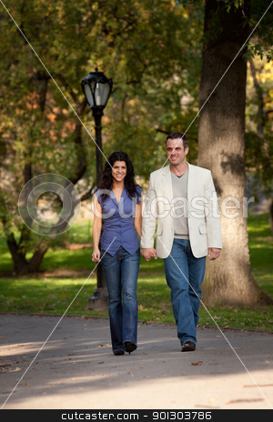 Happy Couple Walk stock photo, A happy couple walking in the park by Tyler Olson