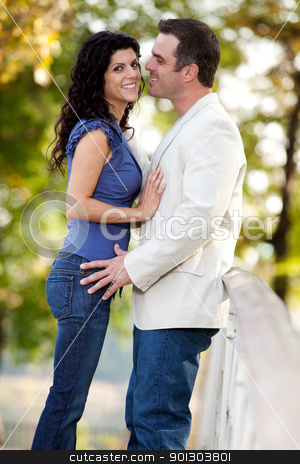 Couple Smile Happy stock photo, A couple in the park with the man smiling at the woman by Tyler Olson