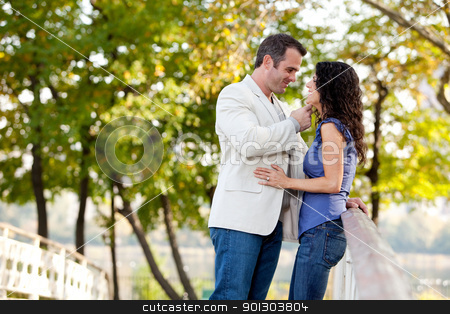 Couple Love stock photo, A couple looking at eachother and smiling by Tyler Olson