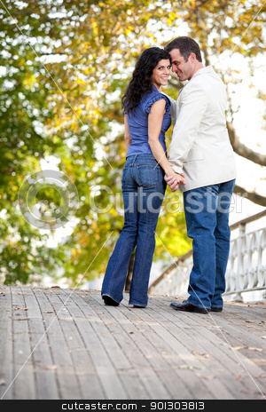 Couple Love stock photo, A happy couple in love walking on a bridge by Tyler Olson