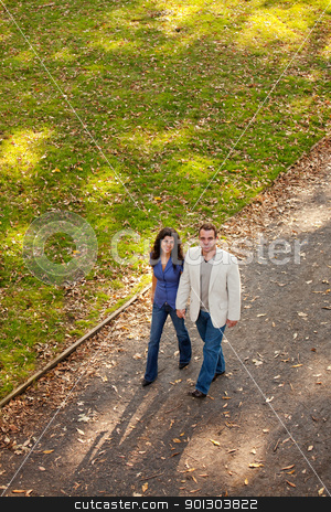 Couple Walk stock photo, A couple walking in a park on a path by Tyler Olson