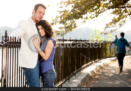 Couple Love Park stock photo, A couple huggnig in the park on a path by Tyler Olson