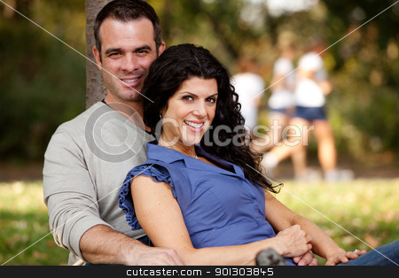 Married Couple stock photo, A happy married couple relaxing in the park - focus on the woman by Tyler Olson