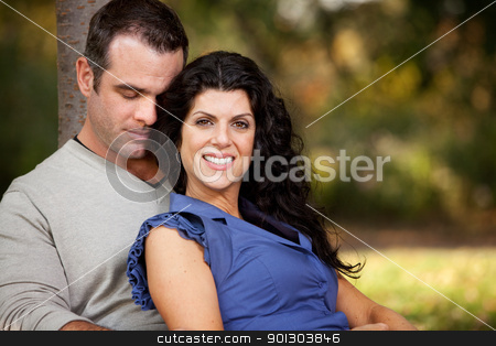 Married Couple stock photo, A happy married couple relaxing in the park by Tyler Olson