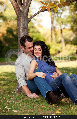Happy Marriage stock photo, A happy couple in the park relaxing and enjoying eachothers company by Tyler Olson