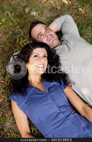 Couple Future Think stock photo, A couple day dreaming while laying on grass by Tyler Olson