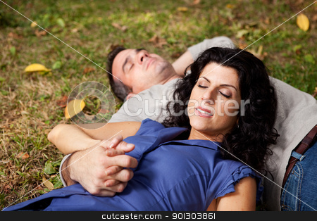 Outdoor Relax stock photo, A couple taking a refreshing break outdoors in a park - sharp focus on female by Tyler Olson