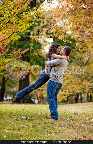 Propose stock photo, A man and woman hugging in a park by Tyler Olson