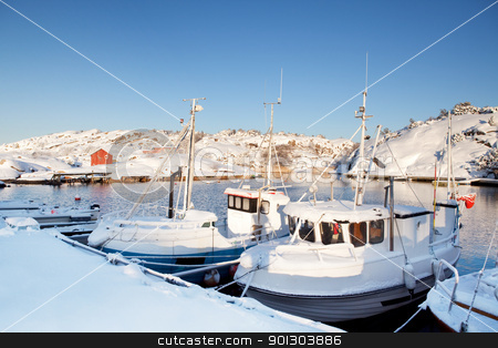 Winter Snow Boat stock photo, A dock in southern Norway with boats covered in snow by Tyler Olson