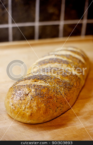 Bread Loaf stock photo, A loaf of whole wheat home made bread - shallow depth of field by Tyler Olson