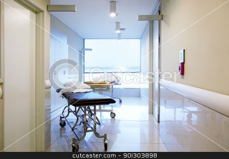 Hospital Interior Hallway stock photo, An intrior of a hospital hallway with a couple stretchers by Tyler Olson