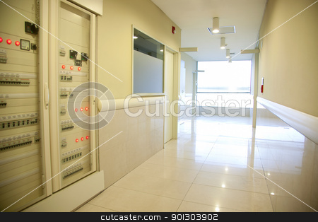 Hospital Hallway stock photo, A hospital hallway with an electronics cabinet and bright window by Tyler Olson
