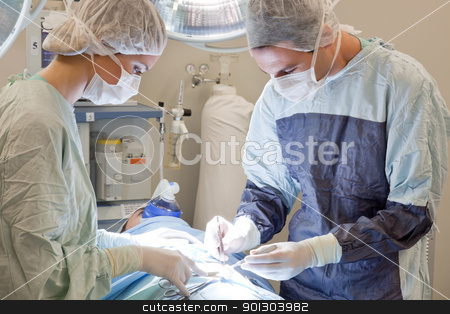 Doctor operating the patient - medical stock photos stock photo, Doctor operating the patient in operation room in hospital - medical stock photos by Tyler Olson