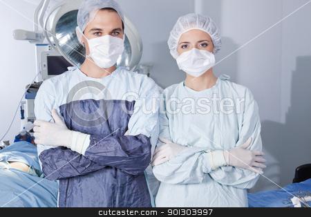 Young confident surgeons stock photo, Portrait of young confident surgeons in operation theatre by Tyler Olson